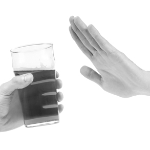 Image of a glass a bear in a hand and another image of a hand help up in the stop position - for the topic Strategies for cutting down
